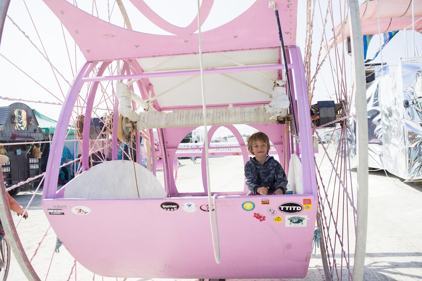 Burning Man - Young boy in big wheels art car