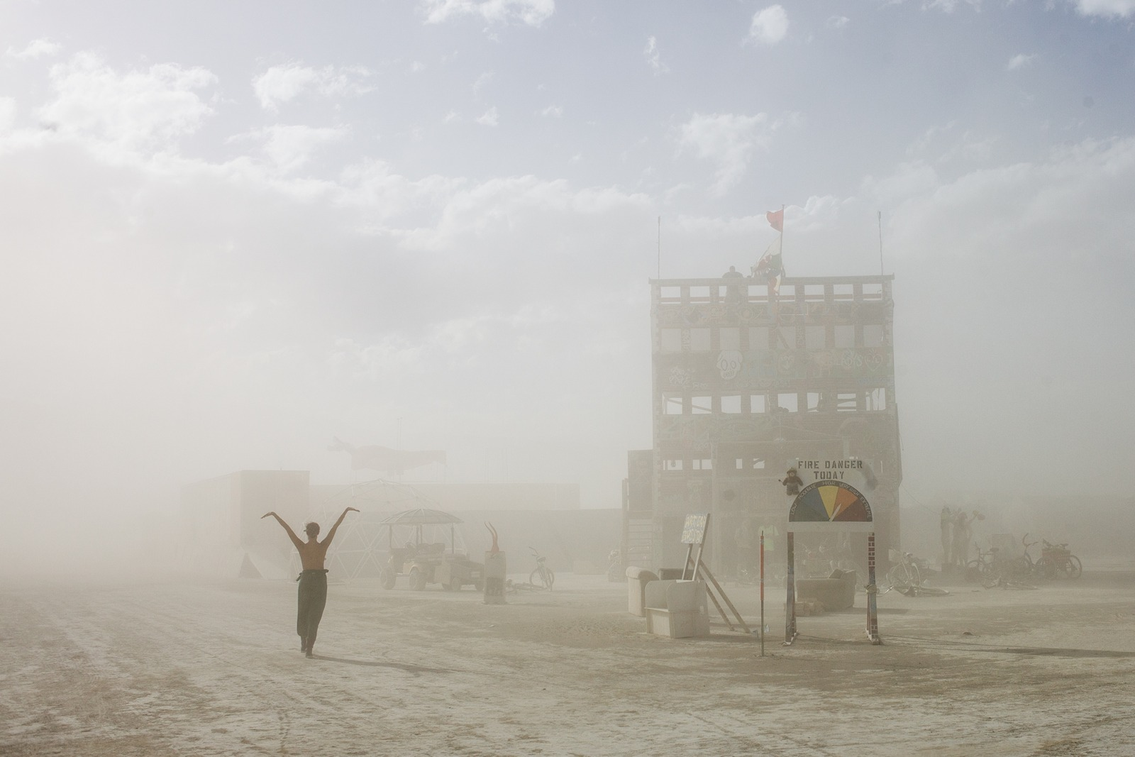 Burning Man - The girl and the firehouse during the sandstorm